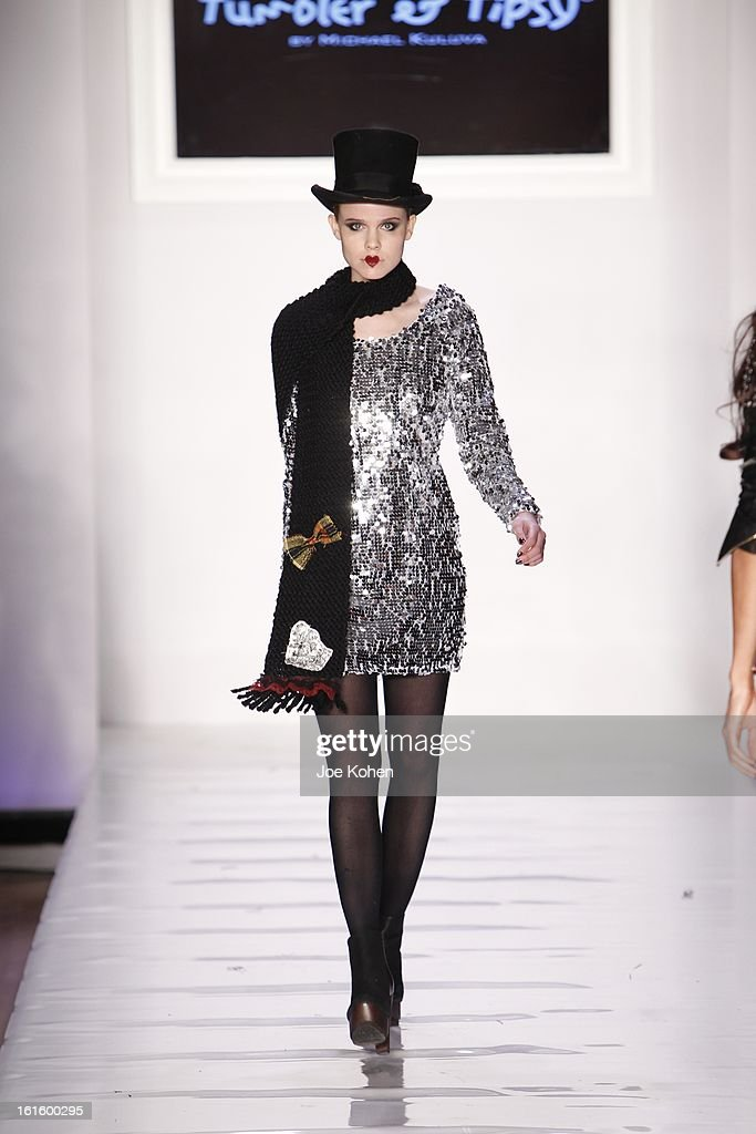 A model walks the runway at the Tumbler And Tipsy By Michael Kuluv fall 2013 fashion show during Conair Style360 at Metropolitan Pavilion on February 12, 2013 in New York City.