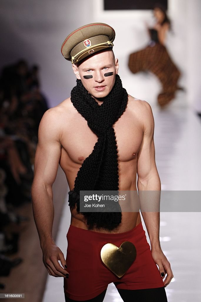A model walks the runway at the Tumbler And Tipsy By Michael Kuluv fall 2013 fashion show during Conair Style360 at Metropolitan Pavilion on February...