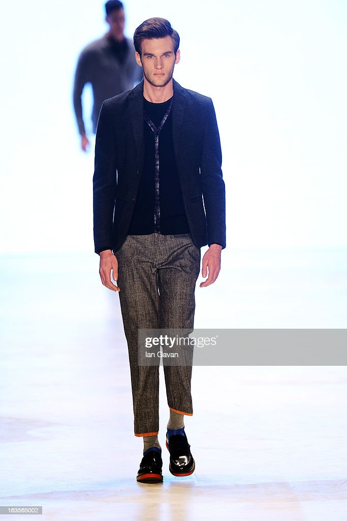 A model walks the runway at the Tween show during Mercedes-Benz Fashion Week Istanbul Fall/Winter 2013/14 at Antrepo 3 on March 12, 2013 in Istanbul, Turkey.