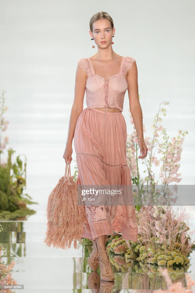 model-walks-the-runway-at-the-ulla-johnson-ss2018-collection-during-picture-id843915284