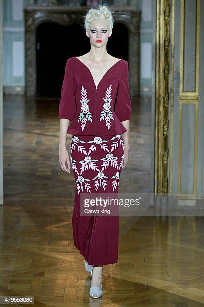 A model walks the runway at the Ulyana Sergeenko Autumn Winter 2015 fashion show during Paris Haute Couture Fashion Week on July 5 2015 in Paris...