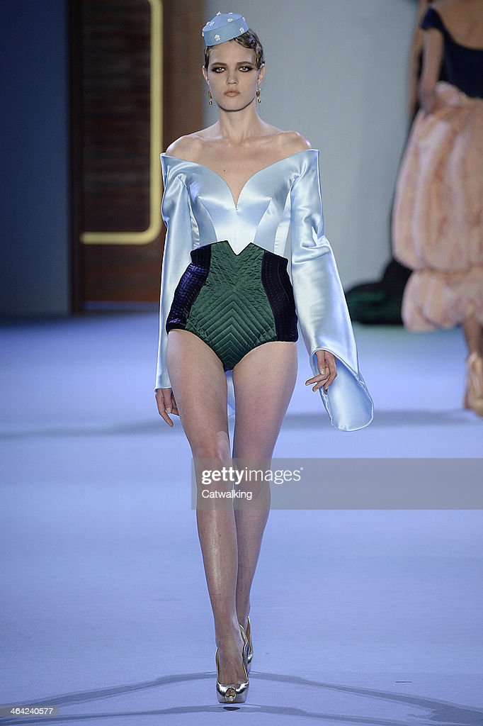A model walks the runway at the Ulyana Sergeenko Spring Summer 2014 fashion show during Paris Haute Couture Fashion Week on January 21, 2014 in Paris, France.