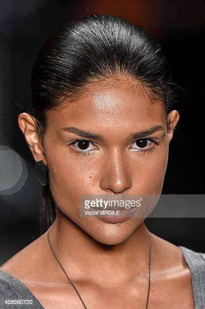 A model walks the runway at the Uma Raquel Davidowicz fashion show during Sao Paulo Fashion Week Winter 2015 at Parque Candido Portinari on November...