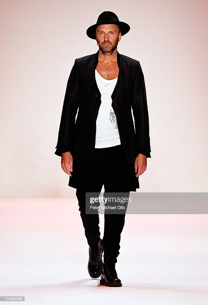 A model walks the runway at the Umasan Show during Mercedes-Benz Fashion Week Spring/Summer 2014 at Brandenburg Gate on July 5, 2013 in Berlin, Germany.