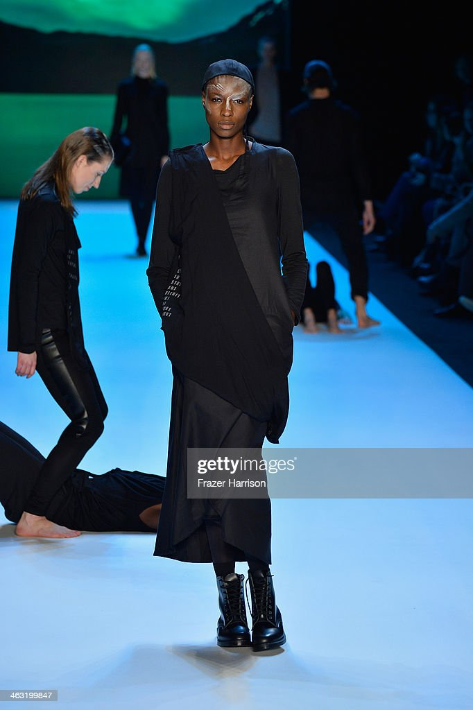 A model walks the runway at the Umasan show during Mercedes-Benz Fashion Week Autumn/Winter 2014/15 at Brandenburg Gate on January 17, 2014 in Berlin, Germany.