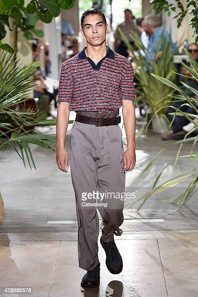 A model walks the runway at the Umit Benan Spring Summer 2016 fashion show during Paris Menswear Fashion Week on June 28 2015 in Paris France
