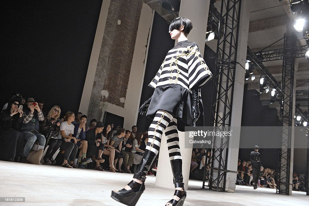 A model walks the runway at the Undercover Spring Summer 2014 fashion show during Paris Fashion Week on September 25, 2013 in Paris, France.