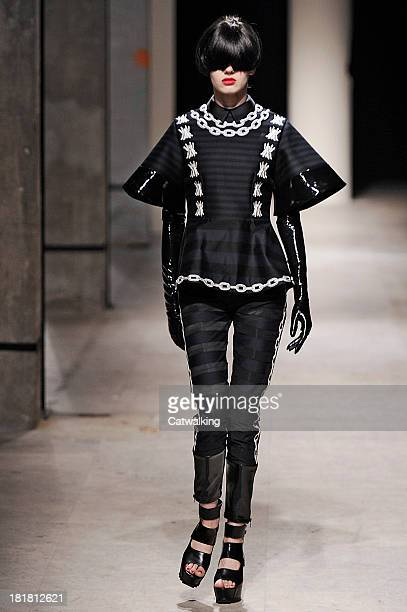 A model walks the runway at the Undercover Spring Summer 2014 fashion show during Paris Fashion Week on September 25 2013 in Paris France