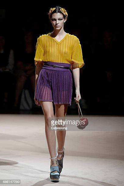 A model walks the runway at the Undercover Spring Summer 2015 fashion show during Paris Fashion Week on September 26 2014 in Paris France