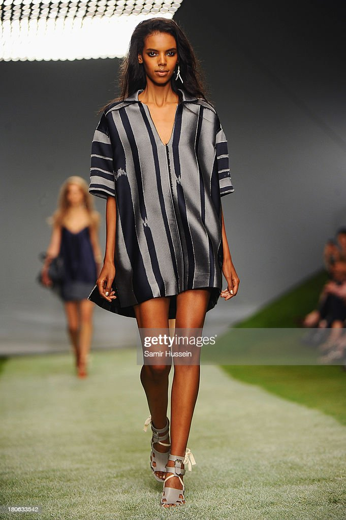 A model walks the runway at the Unique show during London Fashion Week SS14 at TopShop Show Space on September 15, 2013 in London, England.