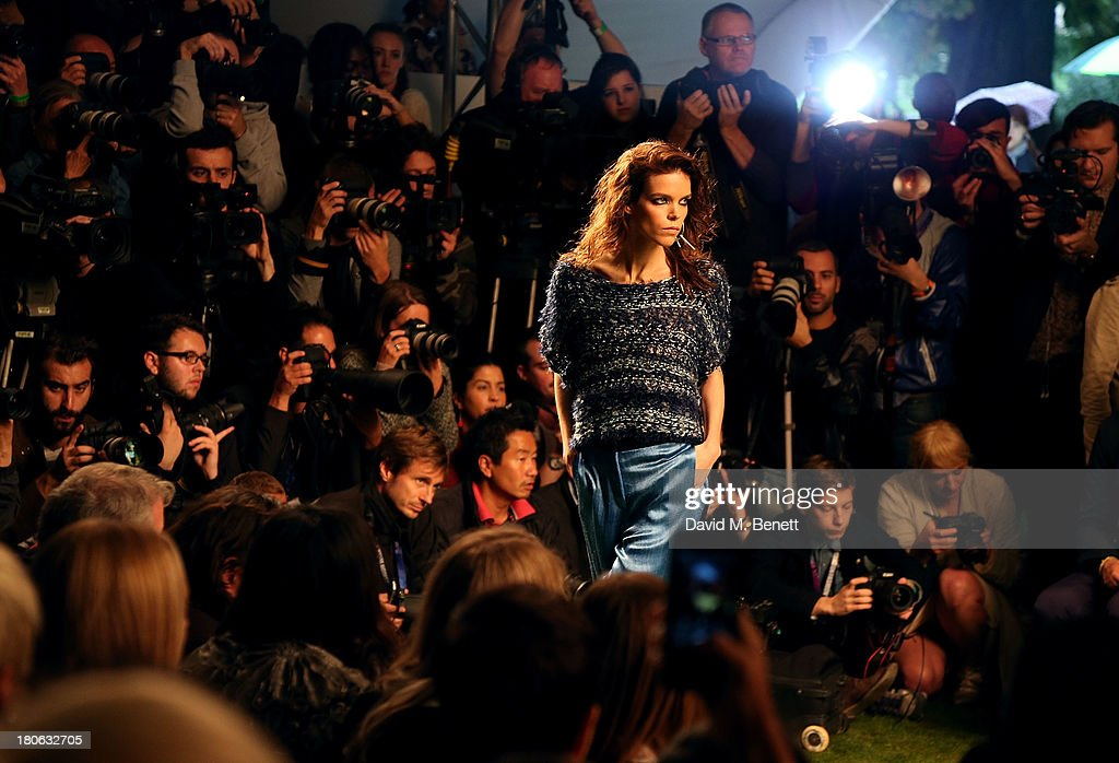 A model walks the runway at the Unique SS14 runway show during London Fashion Week on September 15, 2013 in London, England.