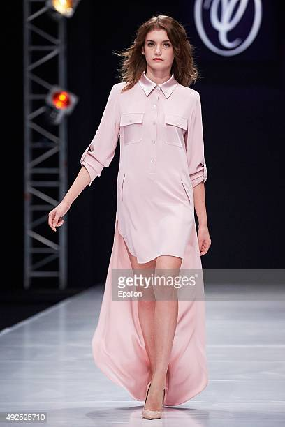 A model walks the runway at the Valentin Yudashkin show during Moscow Fashion Week at Gostiny Dvor on October 13 2015 in Moscow Russia
