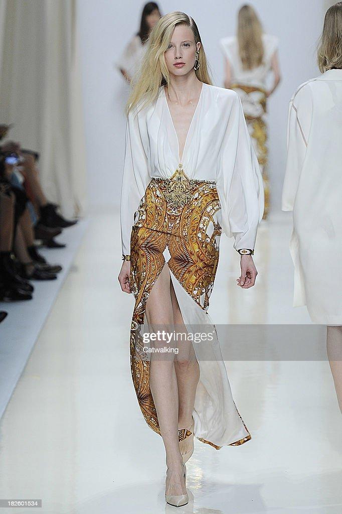 A model walks the runway at the Valentin Yudashkin Spring Summer 2014 fashion show during Paris Fashion Week on October 1, 2013 in Paris, France.