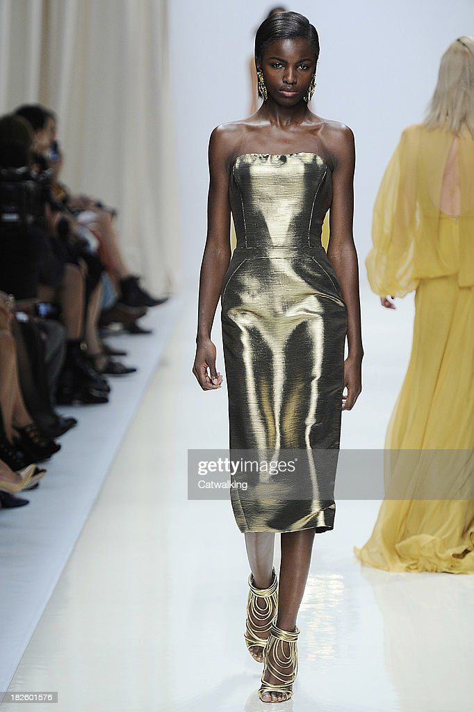 A model walks the runway at the Valentin Yudashkin Spring Summer 2014 fashion show during Paris Fashion Week on October 1, 2013 in Paris, France.