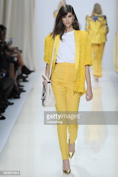 A model walks the runway at the Valentin Yudashkin Spring Summer 2014 fashion show during Paris Fashion Week on October 1 2013 in Paris France