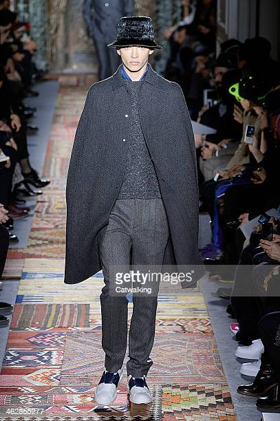 A model walks the runway at the Valentino Autumn Winter 2014 fashion show during Paris Menswear Fashion Week on January 15 2014 in Paris France
