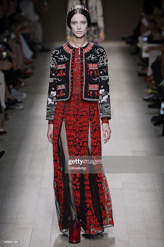 A model walks the runway at the Valentino Spring Summer 2014 fashion show during Paris Fashion Week on October 1, 2013 in Paris, France.