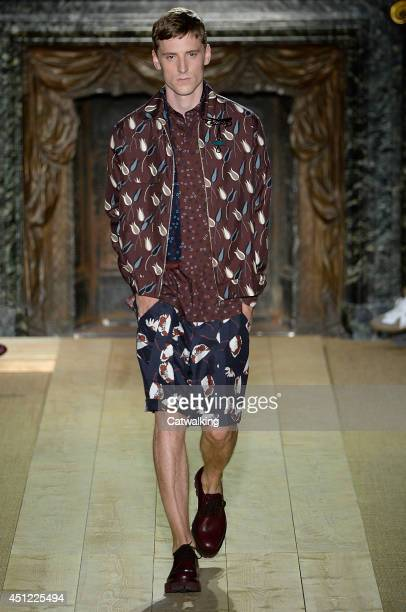 A model walks the runway at the Valentino Spring Summer 2015 fashion show during Paris Menswear Fashion Week on June 25 2014 in Paris France