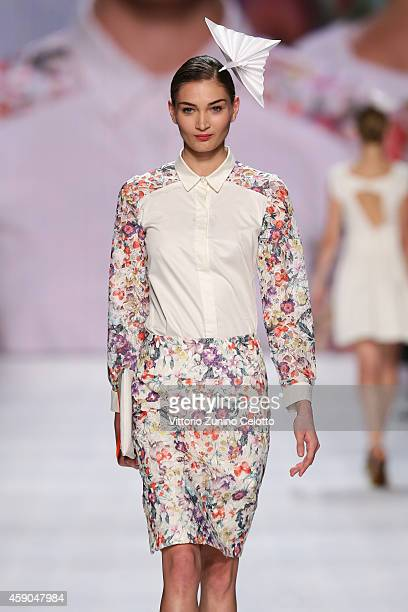 A model walks the runway at the Van Bery show during the MercedesBenz Fashion Days Zurich 2014 on November 15 2014 in Zurich Switzerland