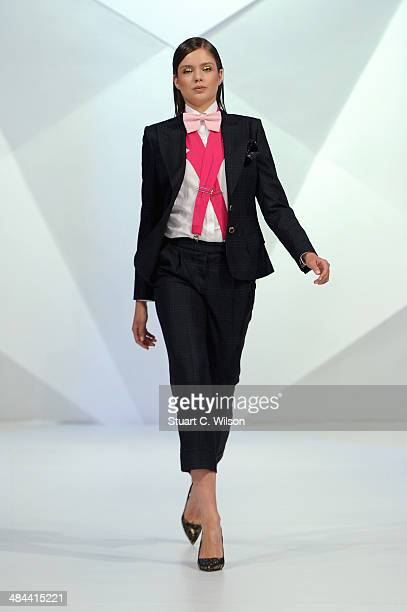 A model walks the runway at the Velsvoir X Patrick Hellmann show during Fashion Forward at Madinat Jumeirah on April 12 2014 in Dubai United Arab...
