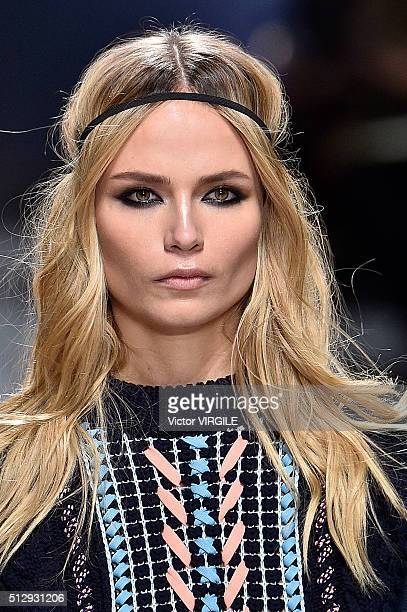 A model walks the runway at the Versace fashion show during Milan Fashion Week Fall/Winter 2016/2017 on February 26 2016 in Milan Italy
