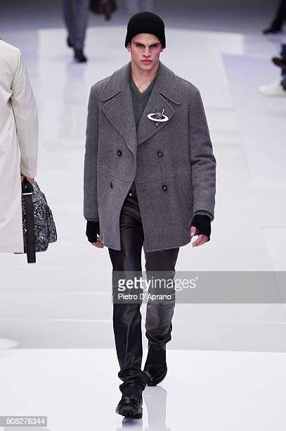 A model walks the runway at the Versace show during Milan Men's Fashion Week Fall/Winter 2016/17 on January 16 2016 in Milan Italy