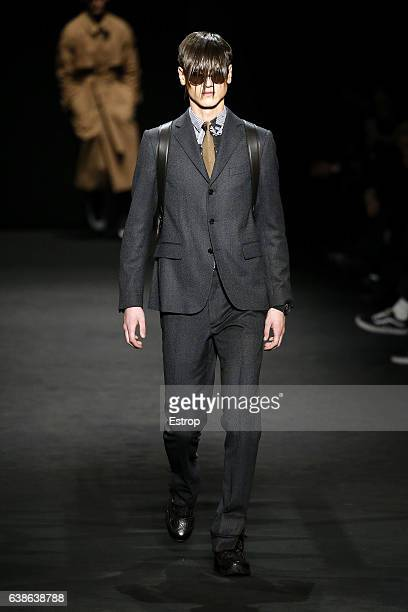 A model walks the runway at the Versace show during Milan Men's Fashion Week Fall/Winter 2017/18 on January 14 2017 in Milan Italy