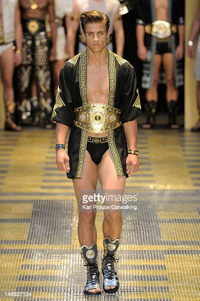 A model walks the runway at the Versace Spring Summer 2013 fashion show during Milan Menswear Fashion Week on June 23 2012 in Milan Italy
