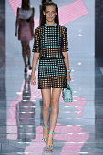 A model walks the runway at the Versace Spring Summer 2015 fashion show during Milan Fashion Week on September 19 2014 in Milan Italy