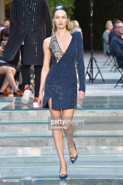 A model walks the runway at the Versace Spring Summer 2018 fashion show during Milan Menswear Fashion Week on June 17 2017 in Milan Italy