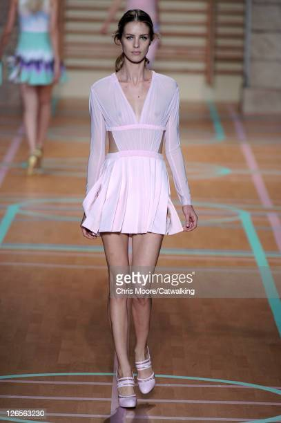 A model walks the runway at the Versus Spring Summer 2012 fashion show during Milan Fashion Week on September 25 2011 in Milan Italy