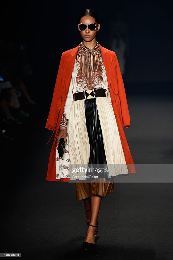 A model walks the runway at the Victor Dzenk fashion show during Sao Paulo Fashion Week Winter 2015 at Parque Candido Portinari on November 3 2014 in...