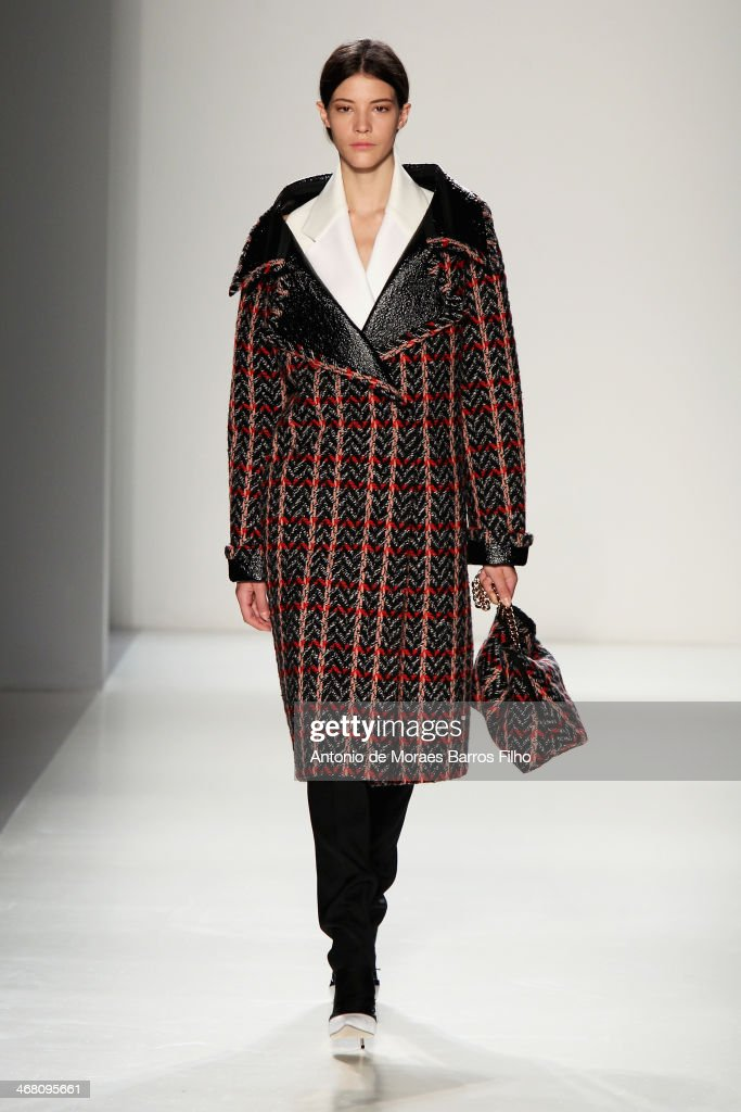 A model walks the runway at the Victoria Beckham presentation during Mercedes-Benz Fashion Week Fall 2014 at Cafe Rouge on February 9, 2014 in New York City.