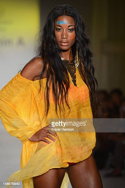A model walks the runway at the Vitamin A by Amahlia Stevens show during MercedesBenz Fashion Week Swim 2013 at The Raleigh on July 20 2012 in Miami...