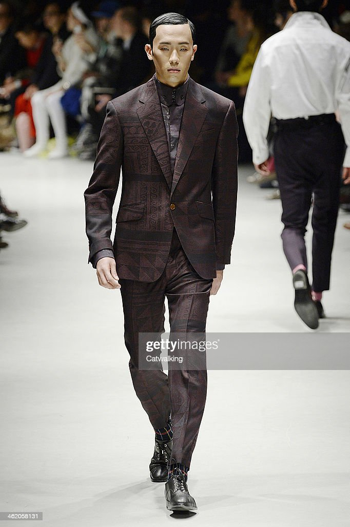 A model walks the runway at the Vivienne Westwood Autumn Winter 2014 fashion show during Milan Menswear Fashion Week on January 12, 2014 in Milan, Italy.