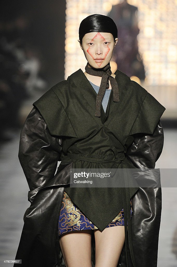 A model walks the runway at the Vivienne Westwood Autumn Winter 2014 fashion show during Paris Fashion Week on March 1, 2014 in Paris, France.