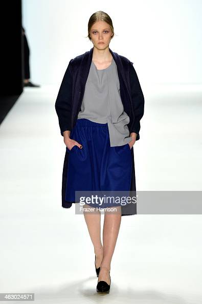 A model walks the runway at the Vladimir Karaleev show during MercedesBenz Fashion Week Autumn/Winter 2014/15 at Brandenburg Gate on January 16 2014...