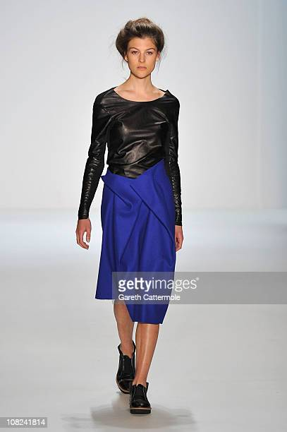 A model walks the runway at the Vladimir Karaleev Show during the Mercedes Benz Fashion Week Autumn/Winter 2011 at Bebelplatz on January 22 2011 in...