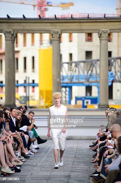A model walks the runway at the Vladimir Karaleev show during the MercedesBenz Fashion Week Spring/Summer 2015 at Kronprinzenpalais on July 10 2014...