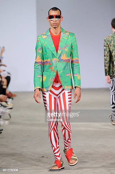A model walks the runway at the Walter Van Beirendonck Spring Summer 2015 fashion show during Paris Menswear Fashion Week on June 25 2014 in Paris...
