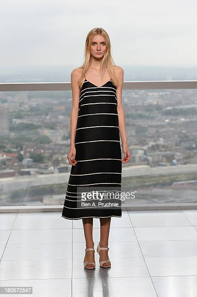 A model walks the runway at the Whistles show during London Fashion Week SS14 at Heron Tower on September 14 2013 in London England