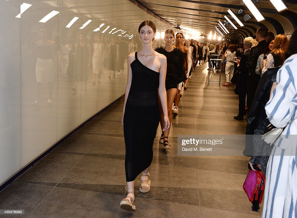 A model walks the runway at the Whistles SS 2015 presentation during London Fashion Week at Kings Cross Tunnel on September 13 2014 in London England