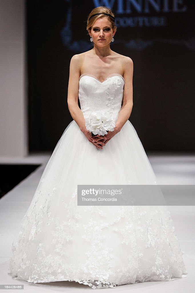 A model walks the runway at the Winnie Coutour Fall 2014 Bridal collection show on October 13, 2013 in New York City.