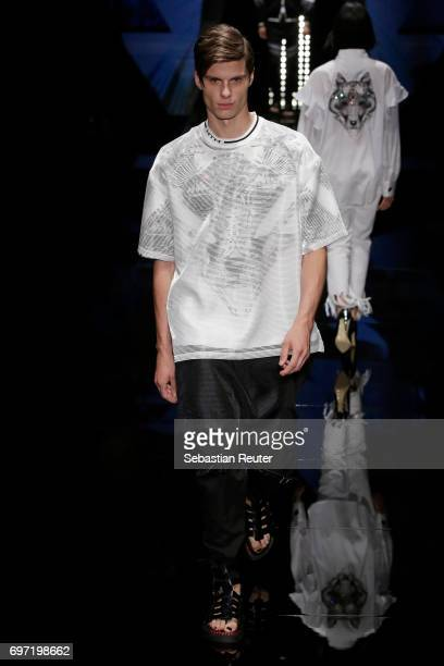 A model walks the runway at the Wolftotem show during Milan Men's Fashion Week Spring/Summer 2018 on June 18 2017 in Milan Italy