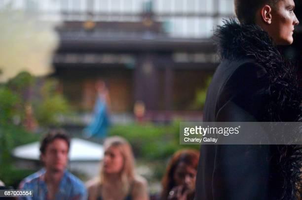 A model walks the runway at the Wolk Morais Collection 5 Fashion Show at Yamashiro on May 22 2017 in Los Angeles California