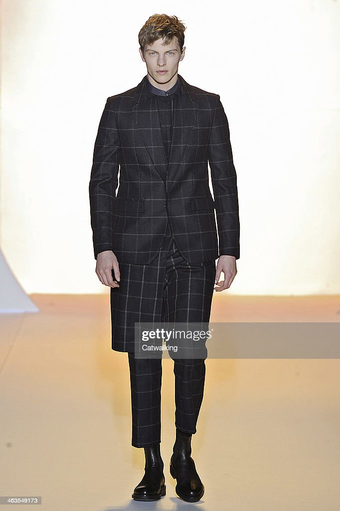 A model walks the runway at the <a gi-track='captionPersonalityLinkClicked' href=/galleries/search?phrase=Wooyoungmi&family=editorial&specificpeople=4823501 ng-click='$event.stopPropagation()'>Wooyoungmi</a> Autumn Winter 2014 fashion show during Paris Menswear Fashion Week on January 18, 2014 in Paris, France.