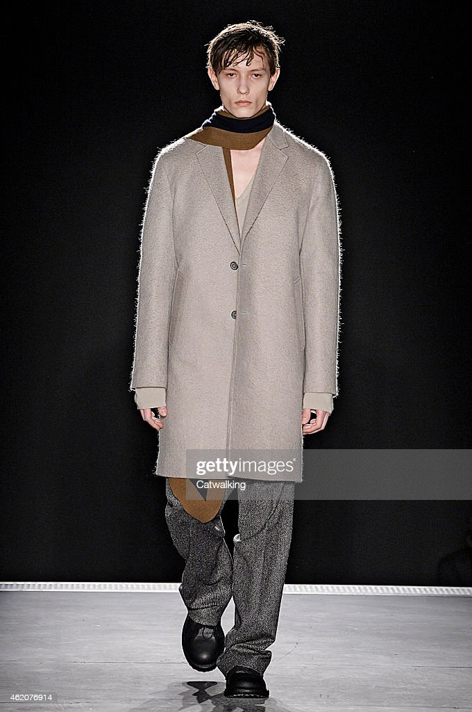 A model walks the runway at the <a gi-track='captionPersonalityLinkClicked' href=/galleries/search?phrase=Wooyoungmi&family=editorial&specificpeople=4823501 ng-click='$event.stopPropagation()'>Wooyoungmi</a> Autumn Winter 2015 fashion show during Paris Menswear Fashion Week on January 24, 2015 in Paris, France.