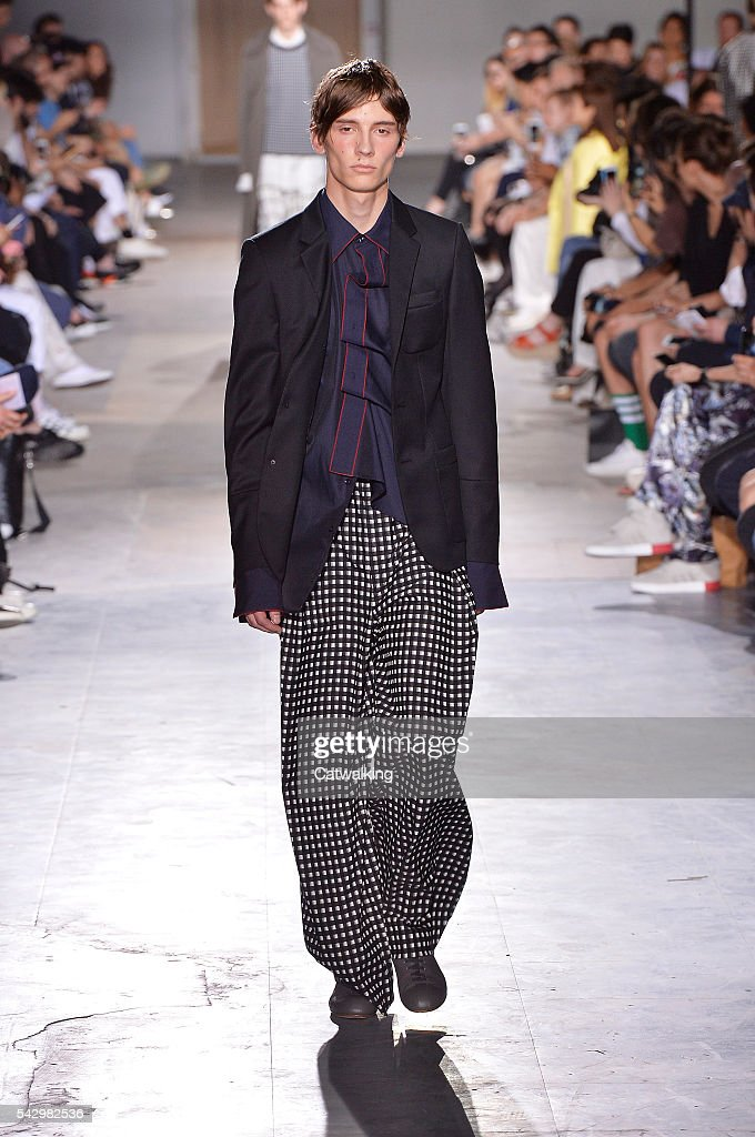 A model walks the runway at the Wooyoungmi Spring Summer 2017 fashion show during Paris Menswear Fashion Week on June 25, 2016 in Paris, France.