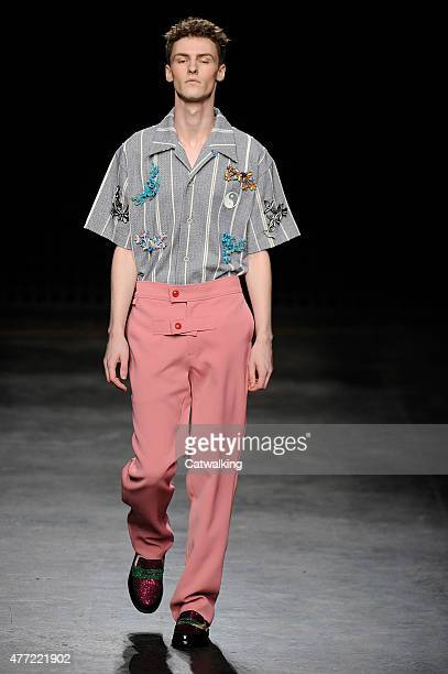 A model walks the runway at the Xander Zhou Spring Summer 2016 fashion show during London Menswear Fashion Week on June 15 2015 in London United...