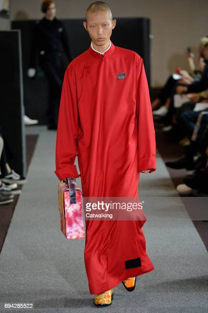 A model walks the runway at the Xander Zhou Spring Summer 2018 fashion show during London Menswear Fashion Week on June 9 2017 in London United...